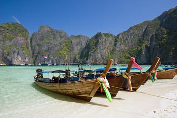 Longtail boats in the famous Maya bay of Phi-phi Leh island