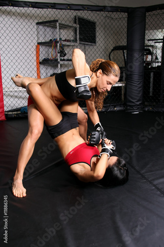 Two women in fight cage
