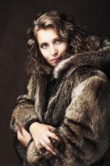 Romantic girl wearing fur jacket