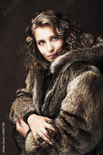 Romantic girl wearing fur jacket