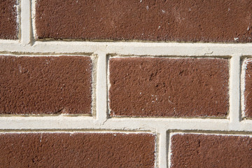 Red brick wall with traditional Dutch point