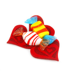 Three red hearts made of cloth and sweets