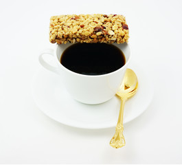 Energy bar with coffee for a quick break from work.