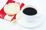 Coffee with a snack of a low calorie rice cake with a napkin. poster