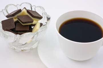 Coffee and sweet white and dark chocolate for a morning break.