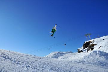 Aeroski: skier touching his ski during jump