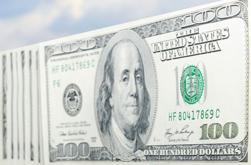 Hundred dollars and blue sky