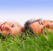 A couple enjoying lying on grass