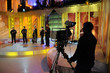 Cameraman works in the studio - recording show in TV studio