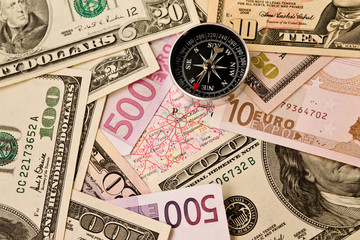 Background from dollars, euro and compass
