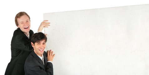 Two businessmen push white plate