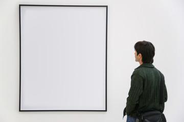 Visitor looks on frame