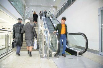 People on ladder and escalator