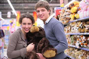 Couple in shop with big soft toy
