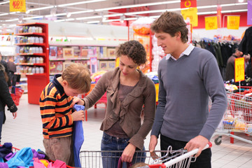 Father and mother with son in supermarket