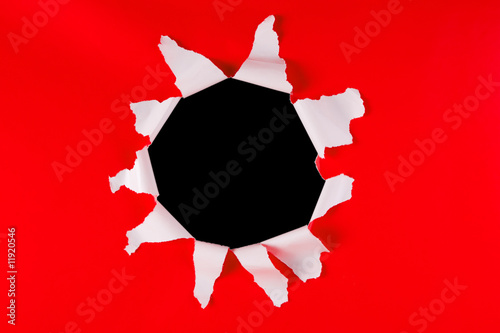 Hole in red paper background