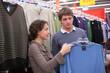 Pair chooses sweater in shop