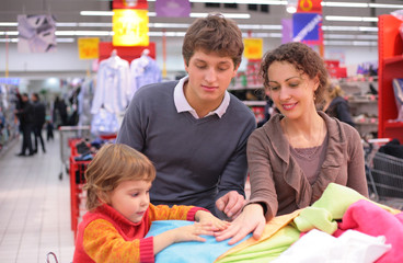 Family choose linen  in shop