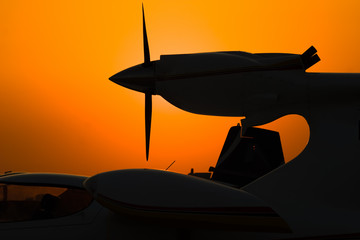 silhouette of airplane engine on sunset