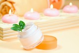 .Moisturizing cream with candles and towel poster