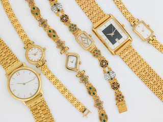 different sizes of gold watches