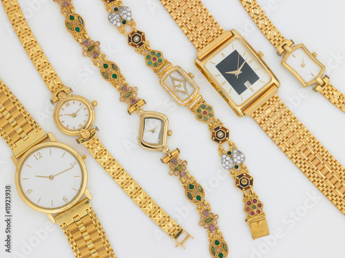 Leinwandbild Motiv different sizes of gold watches