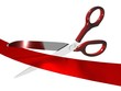 Scissors cutting a red ribbon
