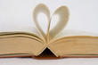 sheets of a book curved into heart shape