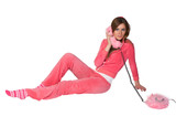 Young beautiful woman in the pink sportswear talking on phone poster