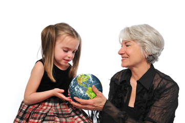 Grandmother and girl holding the earth
