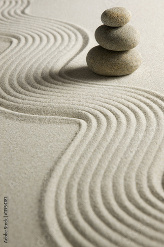 canvas print picture Stack of stones on raked sand