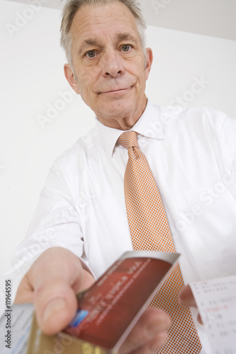 Businessman Holding Credit Cards