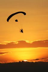 Paraglider silhouette on sunrise