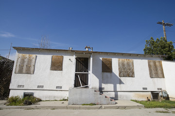 Abandoned House With Boarded Up Windows