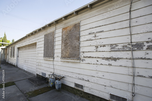 Abandoned Building With Boarded Windows and Peeling Paint