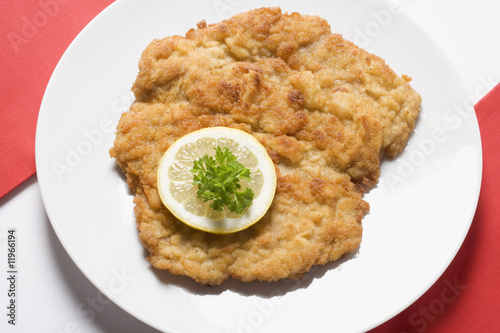 wiener schnitzel (veal escalope) with lemon slice & parsley