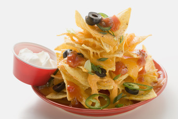 nachos with cheese, olives, chilli rings, ketchup & sour cream