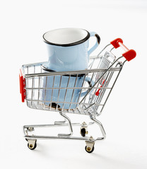 two cups in toy shopping trolley