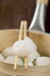 dim sum on chopsticks and in bamboo steamer