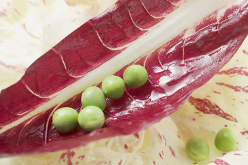 several peas on radicchio
