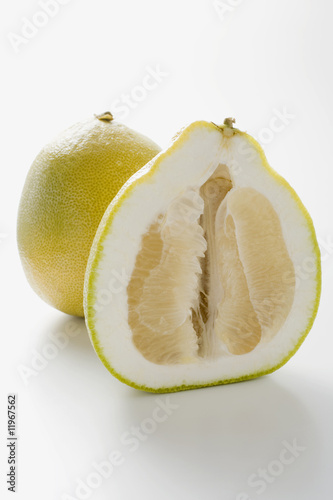 whole pomelo and half a pomelo
