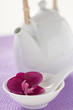 teapot and bowl with spoon and orchid