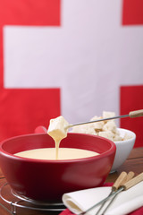 cheese fondue in front of swiss flag