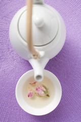 teapot and bowl of rose tea
