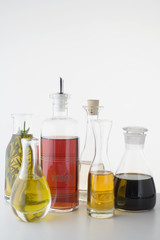 various types of oil and vinegar in bottles