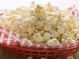 popcorn on napkin in red plastic basket
