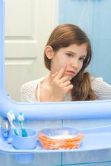 Teen girl in bathroom