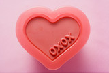 heart-shaped plastic mould with the words xoxo (valentine's day)