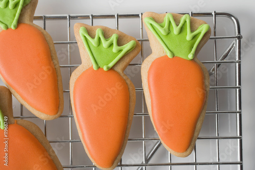 easter biscuits (carrots) on cake rack