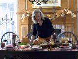 woman serving stuffed turkey for thanksgiving (usa)
